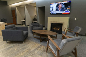 chairs, fireplace, tv in lobby